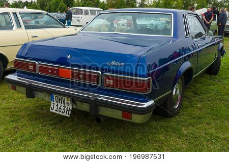 PAAREN IM GLIEN GERMANY - MAY 23 2015: Compact near-luxury car Mercury Monarch coupe 1977. Rear view. The oldtimer show in MAFZ.