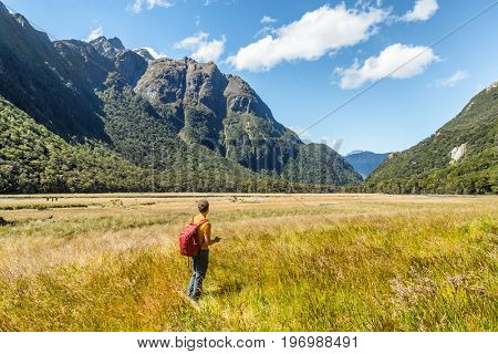 New Zealand tramping hiker man walking at Routeburn Track, Fiordland National Park at Te Anau. Travel destination for hiking.