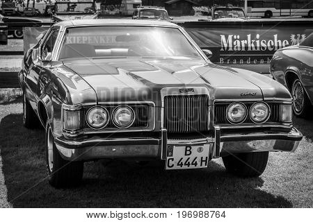 PAAREN IM GLIEN GERMANY - MAY 23 2015: Personal luxury car Mercury Cougar XR-7. Black and white. The oldtimer show in MAFZ.