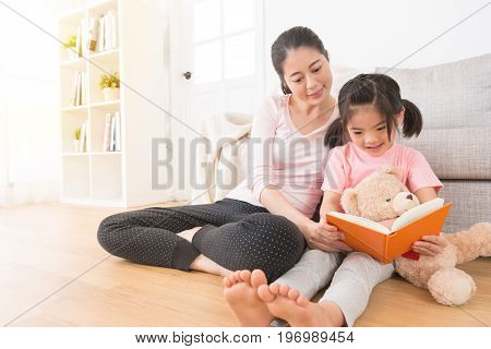 Woman Accompany Children Reading Story Book