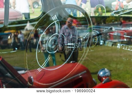 PAAREN IM GLIEN GERMANY - MAY 23 2015: Cabin of a vintage car Packard Super Eight. A view through the glass. The oldtimer show in MAFZ.