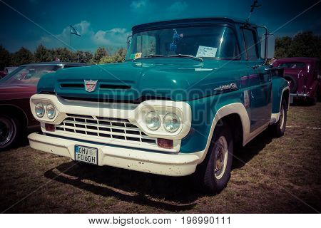 PAAREN IM GLIEN GERMANY - MAY 23 2015: Full-size pickup truck Ford F100 1960. Stylization. Vintage toning. Vignetting. The oldtimer show in MAFZ.