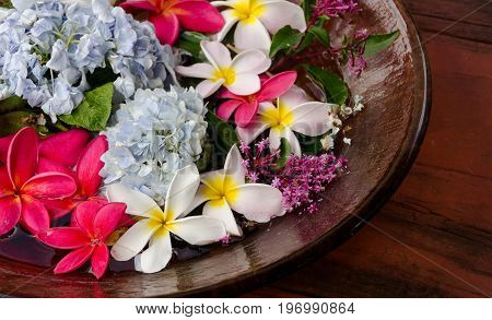 Plumerias On A Wooden Plate
