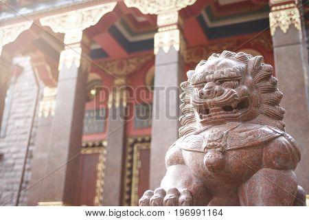 Detail of a Lamaism Datsan temple with stone lion sculpture