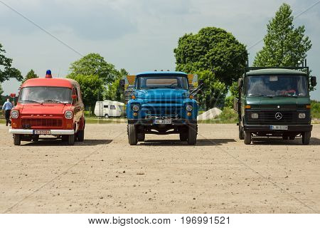 PAAREN IM GLIEN GERMANY - MAY 23 2015: Commercial trucks Ford Transit (left) a popular soviet truck ZIL-130 (center) Mercedes-Benz T2 (right). The oldtimer show in MAFZ.