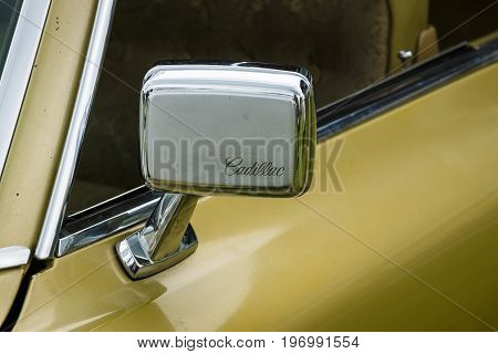 PAAREN IM GLIEN GERMANY - MAY 23 2015: Rear-view mirror of a Cadillac de Ville series 1970. The oldtimer show in MAFZ.