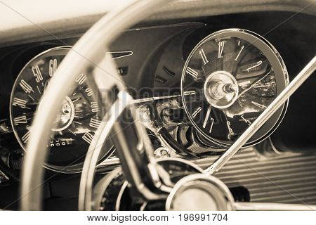 PAAREN IM GLIEN GERMANY - MAY 23 2015: The dashboard of a personal luxury car Ford Thunderbird (third generation). Vintage toning. Stylization. The oldtimer show in MAFZ.