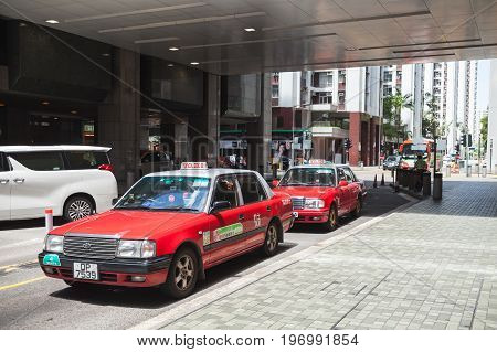 Red Toyota Comfort Taxicabs Stand On The Street