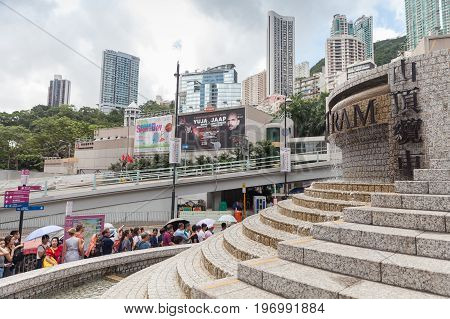 Tourists Wait In Queue For The Peak Tram