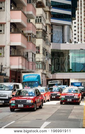 Red Toyota Comfort Taxicabs Go On Street