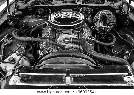 PAAREN IM GLIEN GERMANY - MAY 23 2015: Engine of a muscle car Chevrolet Camaro (second generation) 1979. Black and white. The oldtimer show in MAFZ.