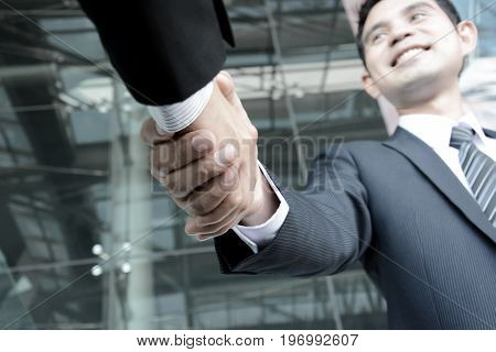 Handshake of businessmen; greeting dealing merger & acquisition concepts - soft focus
