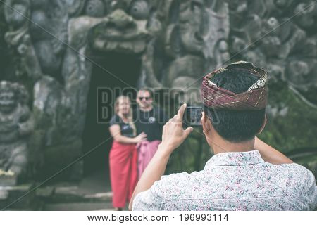 BALI, INDONESIA - JULY 1, 2017: Ancient ruined cave temple Goa Gajah, Ubud, Bali. Elephant temple on Bali.
