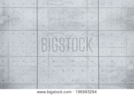 Clean new slab of bare concrete wall background or texture , with seams and dimples. shot perpendicular to image dimension.