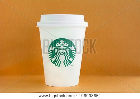 Bangkok Thailand - Mar 04 2015 : Starbucks take away coffee cup with brand logo Starbucks is one of the most world famous coffeehouse chains from USA.
