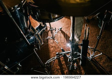 Drum set during live concert closeup. Professional background. Atmospheric rock show