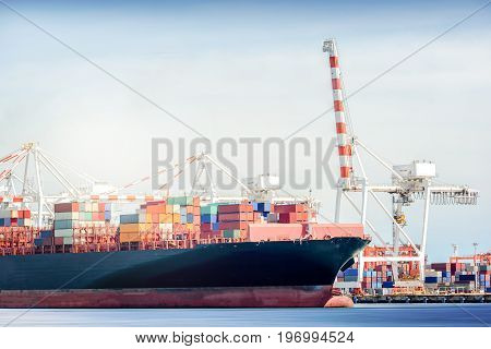International Transportation Shipping Container Cargo freight ship with ports crane bridge in harbor Logistic Import Export background concept un-mooring of containers cargo ship.