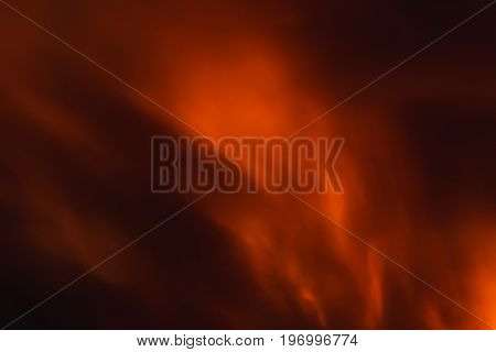 Burning red fire flame with smoke at the night abstract background.