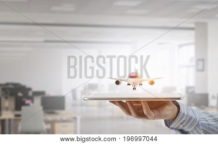 Tablet device in man hand