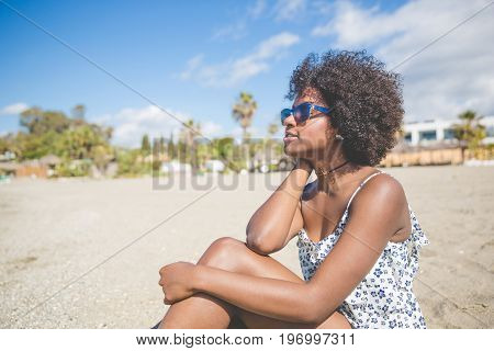 Pretty Afro American Woman Relaxing On Beach