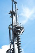 Hydraulic drilling rig in sky with clouds poster