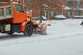 Snow clearing. Tractor clears the way after heavy snowfall. Winter snow tractor snow cleaning poster
