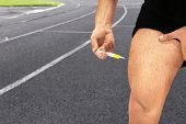 Man injecting steroids and running track on background, closeup. Sport and doping concept poster