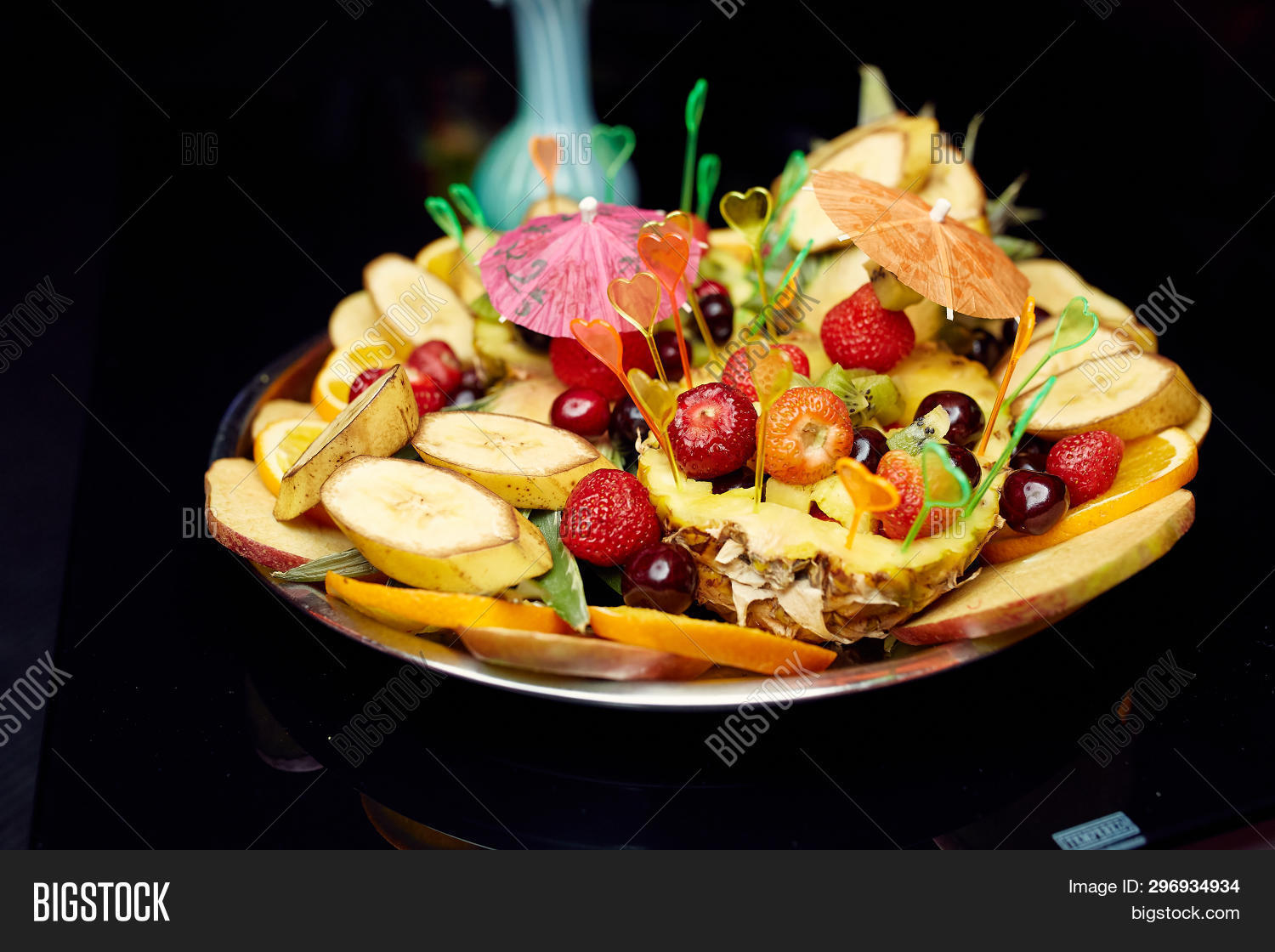 Great Photo Of Fruits In A White Plate On The Black Background