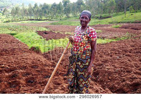 Kinazi, Rwanda - 14 November 2018 : An African Subsistence Farmer In Her Fields