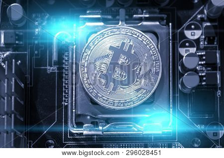 Bitcoin composition. Silver bitcoin among the electronic computer components, business concept of bitcoin digital cryptocurrency. Blockchain technology composition, bitcoin mining concept