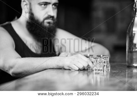 Alcoholism And Depression. Guy Spend Leisure In Bar With Alcohol. Man Drunk Sit Alone In Pub. Alcoho
