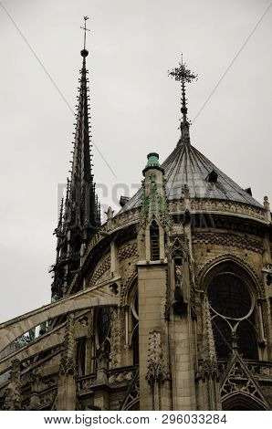 Paris, Circa January 2014: Detail Of Notre Dame De Paris Cathedral With Tower, Which Collapsed In Fi