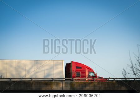 Red Semi Truck 18 Wheeler Side View Profile On Highway