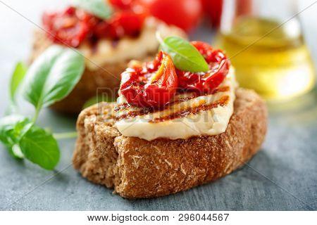 Wholegrain rusk with haloumi and sundried tomato