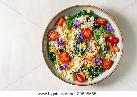 Couscous With Parboiled Vegetables Baby Carrots, Green Beans, Sweet Corn, Spinach Served In Ceramic
