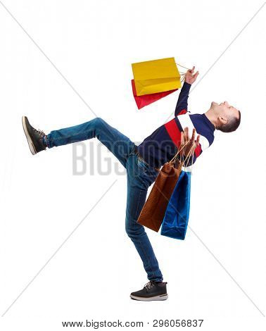 Falling man with shopping bags. Guy in motion.  backside view of person.  Rear view people collection. Isolated over white background.  A stylish guy with a cry falls on his back.