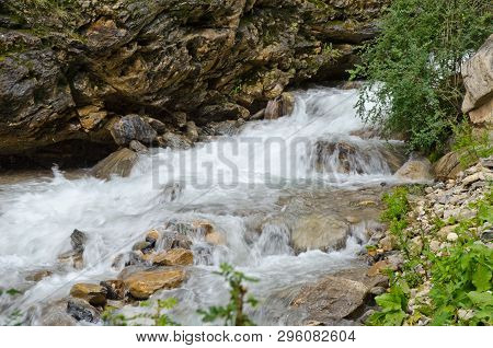 Fast, Affluent And Muddy Mountain Tibetan River (blurred Motion)