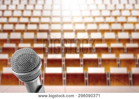 Microphone Voice Speaker Over The Blur Photo Of Empty Seminar Room, Lecture Hall Or Conference Meeti