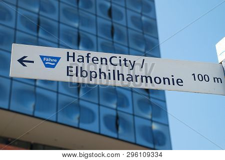 Tourist Road Sign In Hamburg, Germany: Hafencity (harbor City), Elbphilharmonie (concert Hall). In T