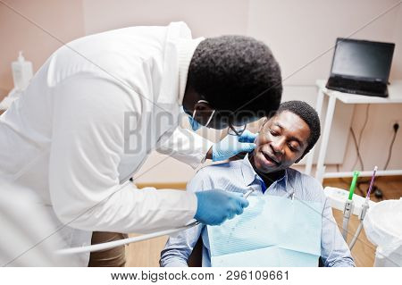 African American Man Patient In Dental Chair. Dentist Office And Doctor Practice Concept. Profession
