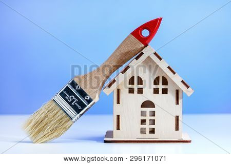 Concept Repair Of House. Brush And Model Of House. Home Repairing, Renovation.