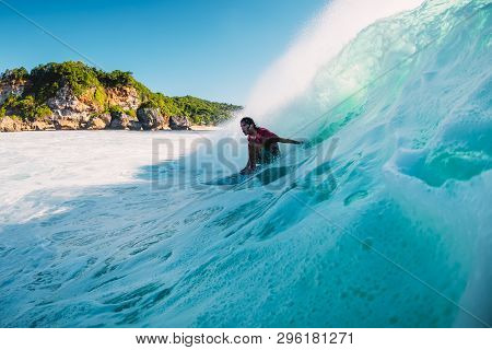 April 18, 2019. Bali, Indonesia. Surfer Ride On Barrel Wave. Professional Surfing At Big Waves In Pa
