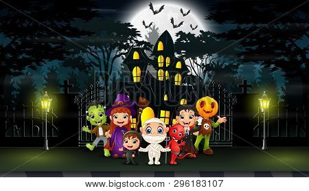 Happy Kids Wearing Halloween Costume Outdoors With The Haunted House