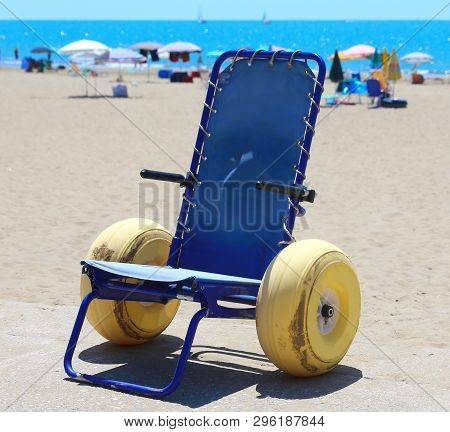 Wheelchair With Large Yellow Wheels To Go In The Sea