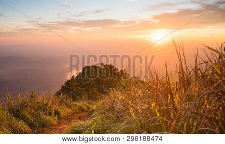 Gold Sunset Light Phu Nom At Phu Langka National Park Thailand With Fog On Sky. Phu Nom At Phu Langk