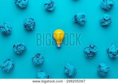 New Idea Concept With Crumpled Office Paper And Light Bulb. Top View Of Great Business Idea Concept