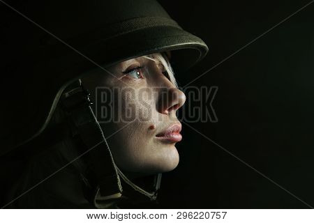 See The Light Of Future In Bloody Color. Close Up Portrait Of Young Female Soldier. Woman In Militar