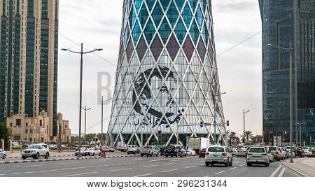 Doha, Qatar - February, 2019: Tornado Tower With Image Of Emir Tamim Bin Hamad Al-thani, Iconic Glas