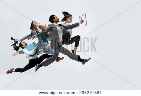 Happy Businesswoman And African Man Dancing In Motion Isolated On White Studio Background. Flexibili