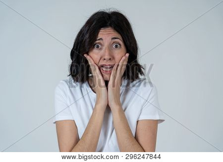 Portrait Of A Young Attractive Woman Looking Scared And Shocked.human Expressions And Emotions